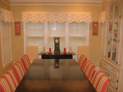 Box pleated valance with scalloped bottom and silhouette shades for dining room windows in Westchester, NY