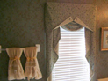 Valance with jabot and wood blinds for bathroom window in NYC