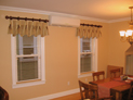 Queen Ann valance on decorative hardware, and wood blinds in New York City